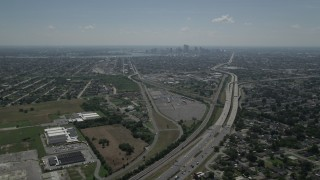 AX59_002 - 5K stock footage aerial video fly over I-10 through Gentilly to approach Downtown New Orleans, Louisiana skyline