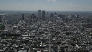 AX59_006 - 5K stock footage aerial video follow Bourbon Street through French Quarter to approach Downtown New Orleans, Louisiana