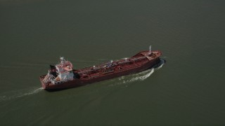 AX59_010 - 5K stock footage aerial video of an oil tanker sailing on Mississippi River, New Orleans, Louisiana