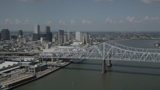 AX59_011 - 5K stock footage aerial video of Crescent City Connection Bridge and Downtown New Orleans skyscrapers, Louisiana