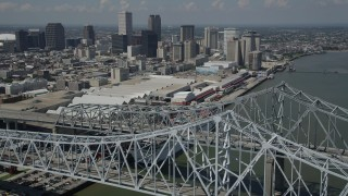 AX59_012 - 5K stock footage aerial video flying over the Crescent City Connection, with view of convention center and Downtown New Orleans, Louisiana