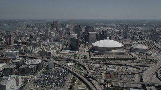 AX59_021 - 5K stock footage aerial video of Downtown New Orleans skyscrapers and the Mercedes-Benz Superdome, Louisiana