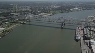 AX59_025 - 5K stock footage aerial video track light traffic crossing the Crescent City Connection Bridge, New Orleans, Louisiana