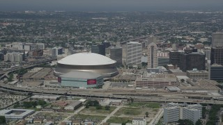 AX59_028 - Aerial stock footage of 5K aerial  video of Mercedes-Benz Superdome and New Orleans Arena, New Orleans, Louisiana