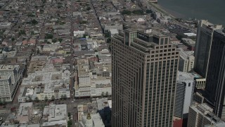 AX59_032 - 5K stock footage aerial video fly over Place St. Charles and tilt to a bird's eye view of the French Quarter, New Orleans, Louisiana