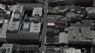 AX59_036 - 5K stock footage aerial video bird's eye view of famous Bourbon Street through the French Quarter, New Orleans, Louisiana