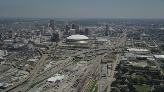 AX59_039 - 5K stock footage aerial video approach the freeway interchange by the Superdome, and Downtown New Orleans skyscrapers, Louisiana