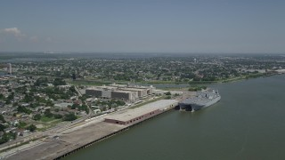 AX59_046 - 5K stock footage aerial video of two military transport ships docked at Bywater, New Orleans, Louisiana
