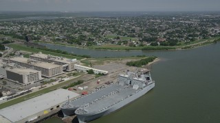 AX59_047 - 5K stock footage aerial video fly over two military transports to approach homes in the Lower Ninth Ward, New Orleans, Louisiana