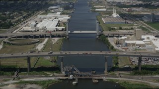 AX59_061 - 5K stock footage aerial video of I-10 High Rise Bridge and Danziger Bridge spanning Industrial Canal, New Orleans, Louisiana