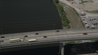 AX59_062 - 5K stock footage aerial video track cars crossing the I-10 High Rise Bridge, New Orleans, Louisiana