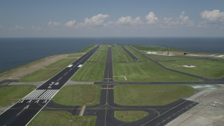 AX59_066 - 5K stock footage aerial video of runways and control tower at the New Orleans Lakefront Airport, Louisiana