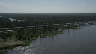 AX60_004 - 5K stock footage aerial video of light traffic on Interstate 10 beside swamp in Norco, Louisiana