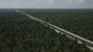 AX60_010 - 5K stock footage aerial video of Interstate 10 through swampland in La Place, Louisiana