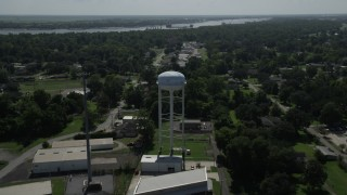 AX60_013 - 5K stock footage aerial video fly over trailer park and approach a water tower, La Place, Louisiana