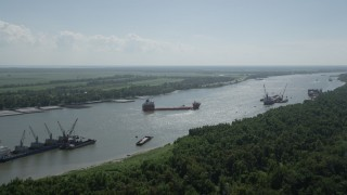 AX60_014 - 5K stock footage aerial video approach cargo ships anchored on Mississippi River near LaPlace, Louisiana