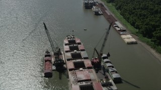 AX60_015 - 5K stock footage aerial video approach and tilt to a cargo ship on Mississippi River, Louisiana