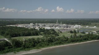 AX60_017 - 5K stock footage aerial video of flying away from the Dupont Chemical Plant in LaPlace, Louisiana