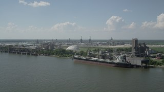 AX60_019 - 5K stock footage aerial video flyby grain elevator and cargo ship near oil refinery in Reserve, Louisiana