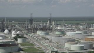 AX60_021 - 5K stock footage aerial video of oil tanks and flare stacks at the Marathon Garyville Refinery in Reserve, Louisiana