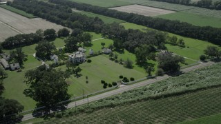 AX60_024 - 5K stock footage aerial video of the Evergreen Plantation house and grounds in Edgard, Louisiana