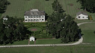 AX60_026 - 5K stock footage aerial video orbit the Evergreen Plantation and gardens in Edgard, Louisiana