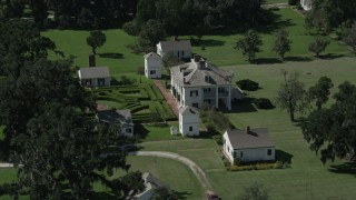AX60_027 - 5K stock footage aerial video orbit the Evergreen Plantation main and side buildings in Edgard, Louisiana