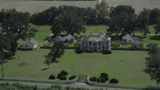 AX60_028 - 5K stock footage aerial video orbit the main house and grounds of Evergreen Plantation, Edgard, Louisiana