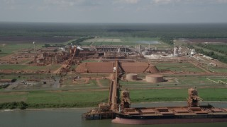AX60_031 - 5K stock footage aerial video of Gramercy Alumina plant and docked cargo ship in Gramercy, Louisiana