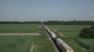 AX60_063 - 5K stock footage aerial video fly over train cars and sugar cane fields in Vacherie, Louisiana