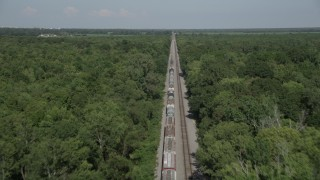 AX60_065 - 5K stock footage aerial video fly over train cars to approach the engine, Edgard, Louisiana