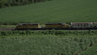 AX60_068 - 5K stock footage aerial video track a train racing by sugar cane fields, Edgard, Louisiana