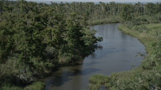 AX60_092 - 5K stock footage aerial video of following a narrow river through a swamp in St. Charles Parish, Louisiana