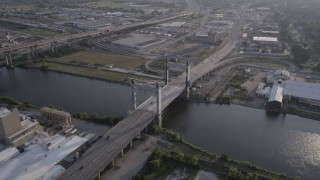 AX61_003 - 5K stock footage aerial video of cars crossing Danziger Bridge, spanning Industrial Canal at sunset, New Orleans, Louisiana