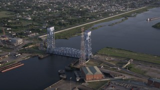 AX61_005 - 5K stock footage aerial video the Florida Avenue Bridge, spanning Industrial Canal at sunset, New Orleans, Louisiana