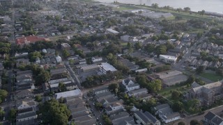 AX61_007 - 5K stock footage aerial video fly over an urban neighborhood at sunset in Algiers, Louisiana