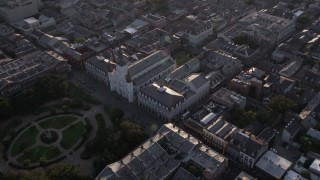 AX61_011 - 5K stock footage aerial video of St. Louis Cathedral and Jackson Square at sunset, New Orleans, Louisiana