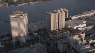 AX61_013 - 5K stock footage aerial video of World Trade Center and Hilton Riverside Hotel at sunset, New Orleans, Louisiana
