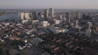 AX61_016 - 5K stock footage aerial video of Downtown New Orleans at sunset, seen from French Quarter and Iberville, Louisiana