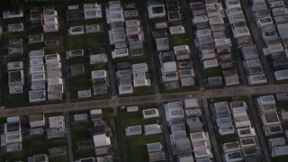 AX61_021 - 5K stock footage aerial video of McDonoghville Cemetery in Gretna at sunset, Louisiana