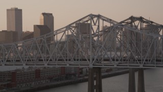 AX61_024 - 5K stock footage aerial video of light traffic on Crescent City Connection Bridge at sunset, New Orleans, Louisiana