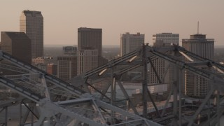 AX61_025 - 5K stock footage aerial video fly over Crescent City Connection, and focus on skyscrapers, Downtown New Orleans, Louisiana, sunset