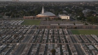 AX61_032 - 5K stock footage aerial video fly over Greenwood Cemetery toward First Baptist New Orleans Church at sunset, Louisiana