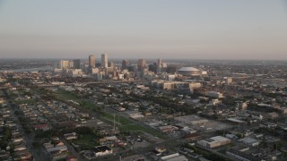 AX61_036 - 5K stock footage aerial video approach high-rises and skyscrapers in Downtown New Orleans at sunset, Louisiana