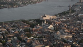 AX61_038 - 5K stock footage aerial video of St. Louis Cathedral and Jackson Square at sunset, French Quarter, New Orleans, Louisiana
