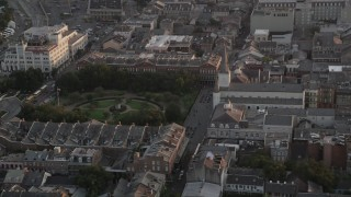 AX61_039 - 5K stock footage aerial video of St. Louis Cathedral and Jackson Square at sunset in the French Quarter of New Orleans, Louisiana