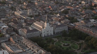 AX61_041 - 5K stock footage aerial video orbit St. Louis Cathedral by Jackson Square in the French Quarter at sunset, New Orleans, Louisiana