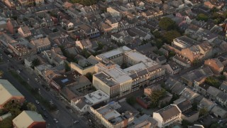 AX61_042 - 5K stock footage aerial video orbit French Quarter city streets and buildings at sunset, New Orleans, Louisiana