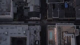 AX61_047 - 5K stock footage aerial video of bird's eye view of Bourbon Street in the French Quarter of New Orleans at sunset, Louisiana