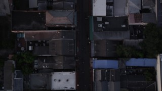 AX61_048 - 5K stock footage aerial video of bird's eye of famous Bourbon Street in the New Orleans French Quarter, Louisiana at twilight
